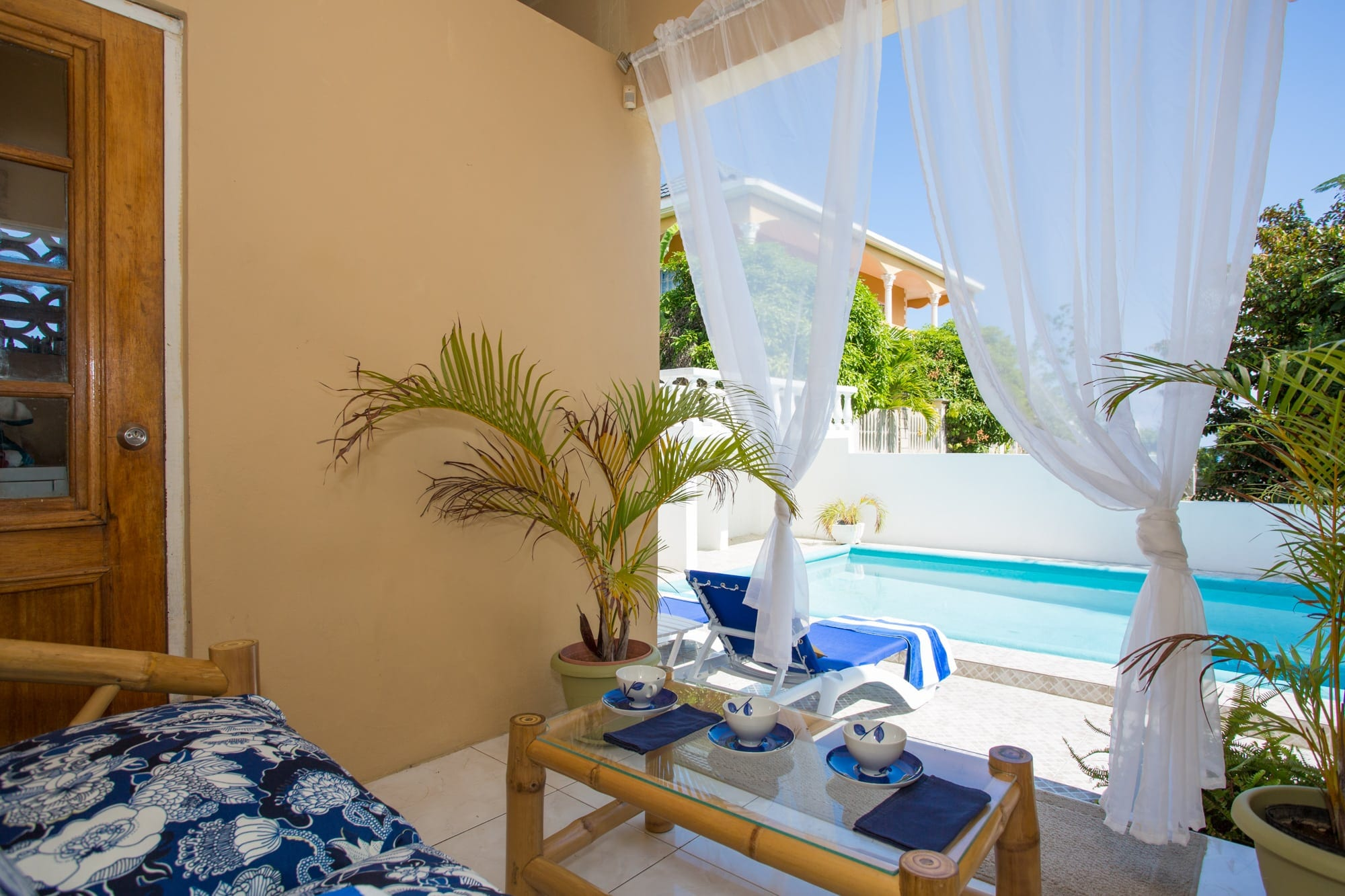 Savour a Jamaican Blue Mounatain Coffee overlooking the tropical pool