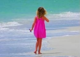 Child on the beach in Jamaica