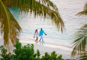 couple walking on the beach in Jamaica