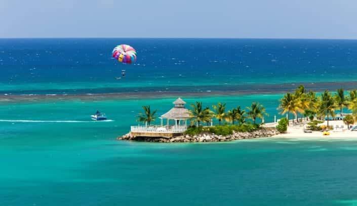 Parasailing over the tropical island of Ocho Rios, Jamaica.